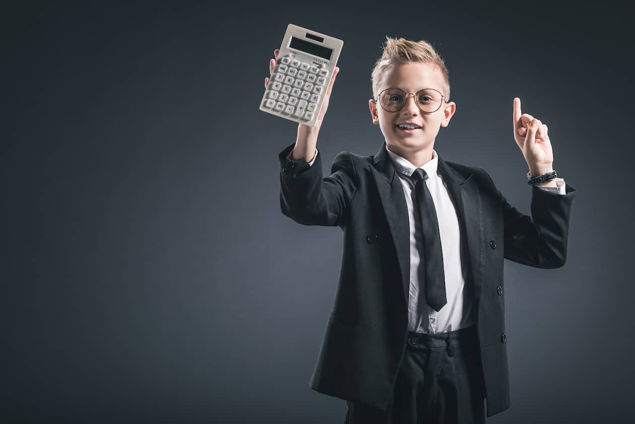 Boy in suit holding calculator